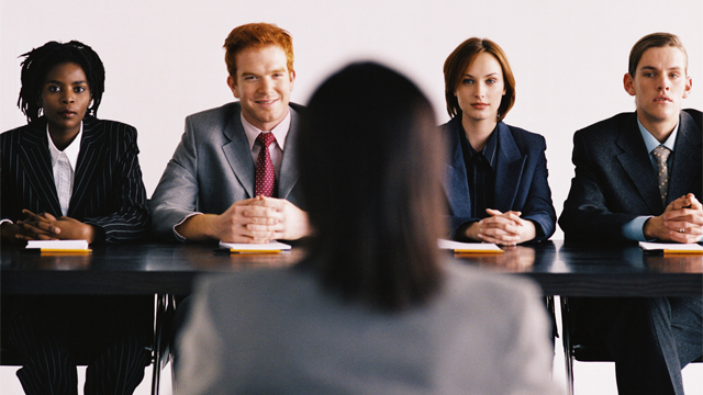 view of a team of business executives sitting at a table